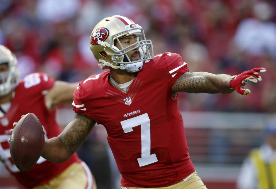Colin+Kaepernick+throws+a+72+yard+touchdown+pass+against+Baltimore+Ravens+on+Sunday%2C+Oct.+18th.+Kaepernick+refused+to+stand+for+the+national+anthem+prior+to+the+preseason+matchup+against+the+Green+Bay+Packers+Aug.+26.+Green+Bay+won+the+game+21-10