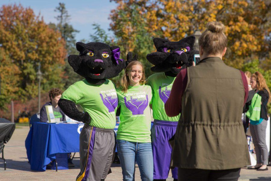 Students posed with TC and TK at the kick off event while supporting the You Matter at UNI shirts.