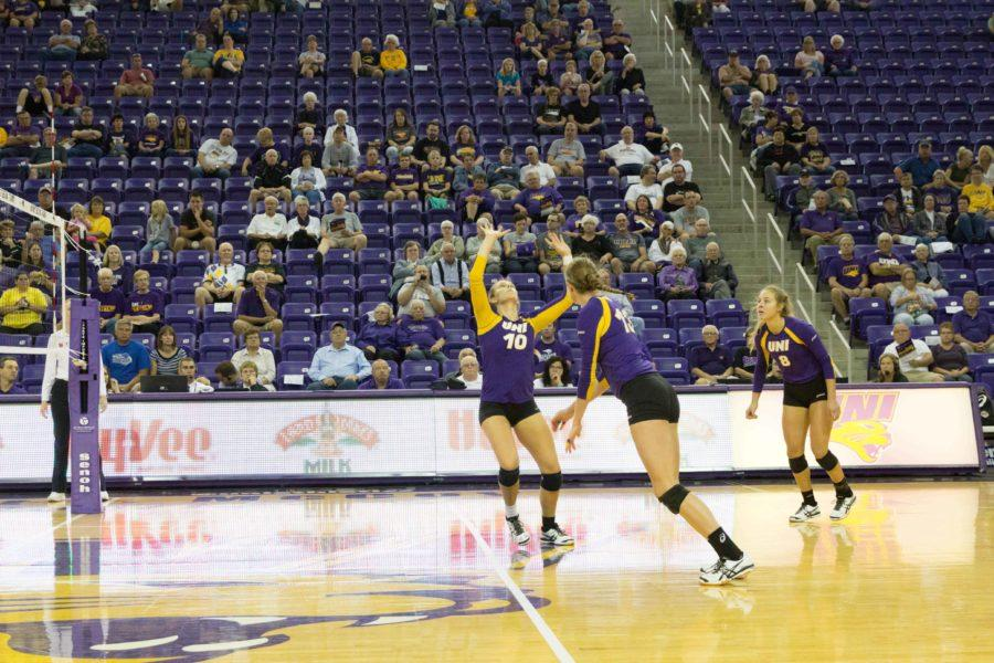 Heather Hook (10) sets up Kayla Haneline (13) alongside teammate Ashlee Sinnott (8) during an early-season home game. UNI finished the regular season 24-10. (14-4 within the MVC, 12-3 at home and 8-5 on the road)