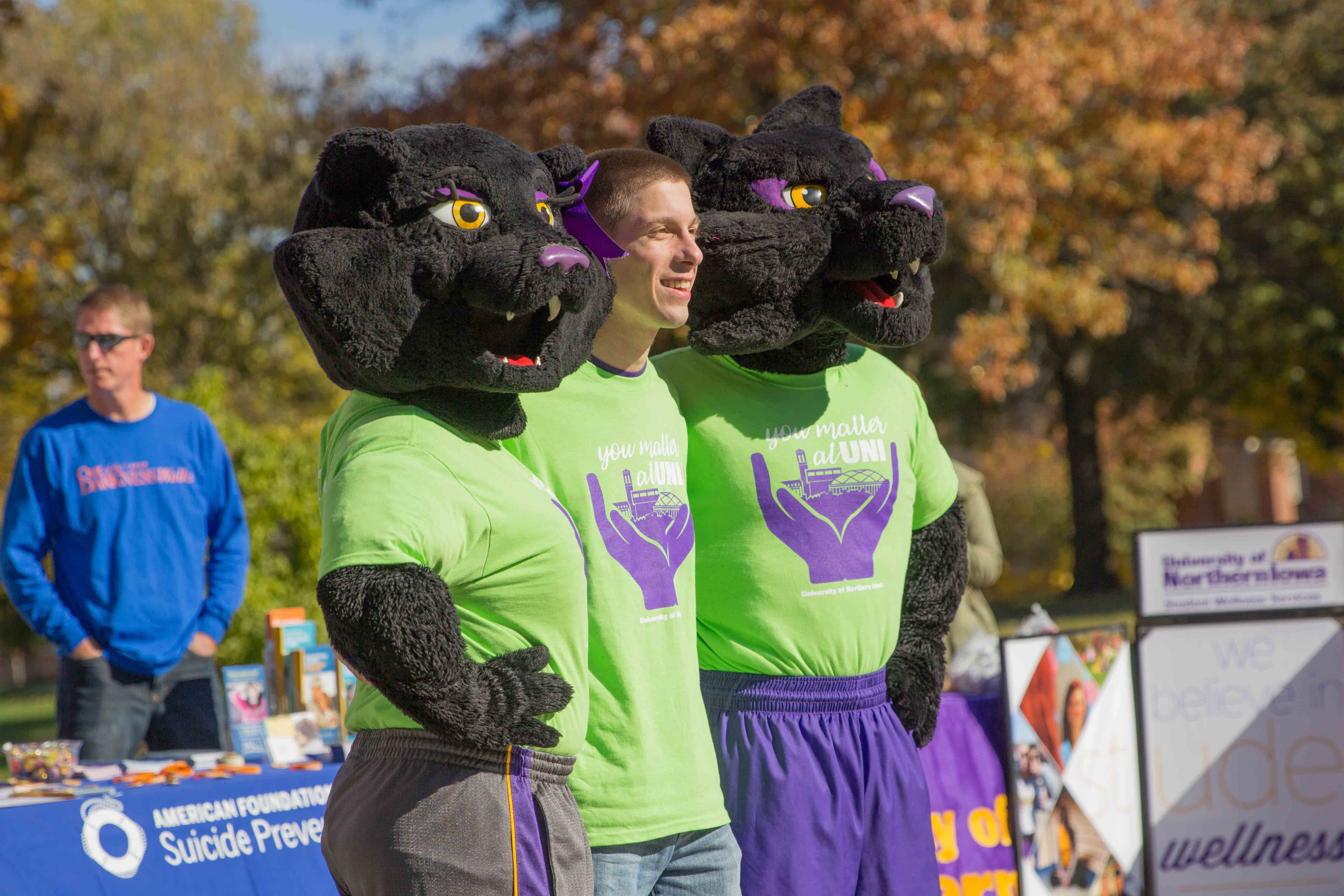 NISG President, Hunter Flesch, stands with UNI's mascots at the first Mental Health Awareness week earlier this semester. Some students have questioned the event's success. Columnist Friel wonder whether it's fair to criticize event planning skills of NISG leaders.