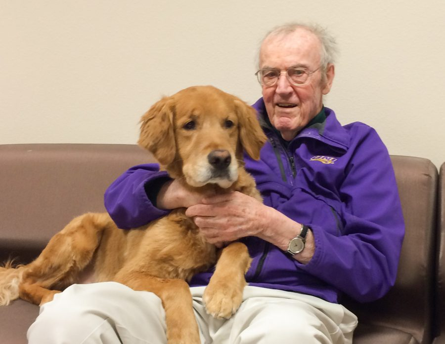 Donald Shepardson, pictured with history department head Robert Martin's service dog Nick, taught at five different universities in his lifetime. He began teaching at UNI in 1970 and specialized in military and diplomatic history.