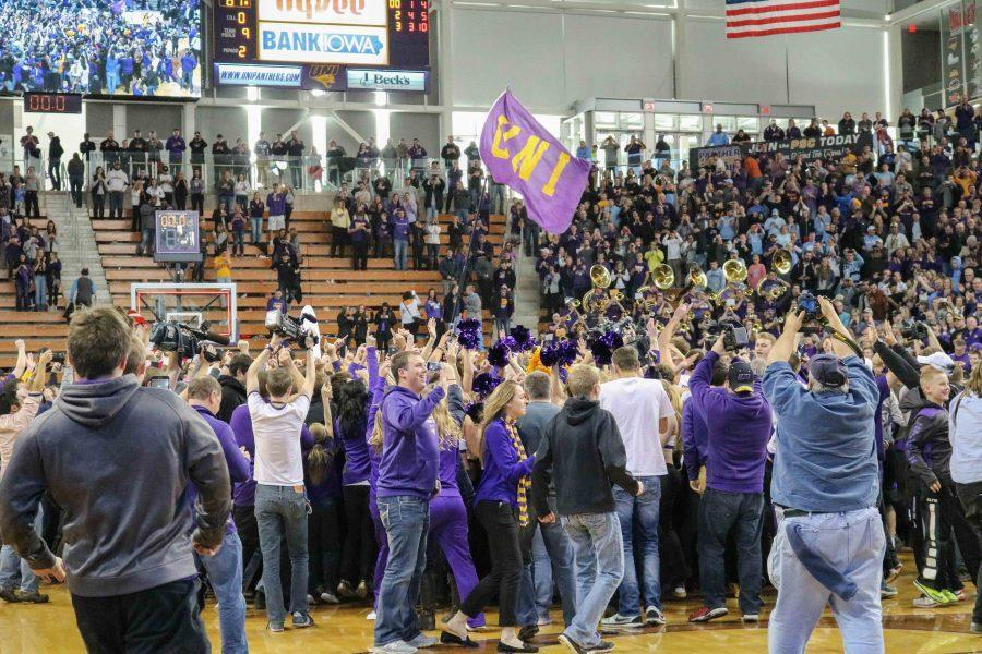Students+and+fans+storm+the+court+after+UNI%27s+victory+over+North+Carolina+from+last+year%27s+season.+