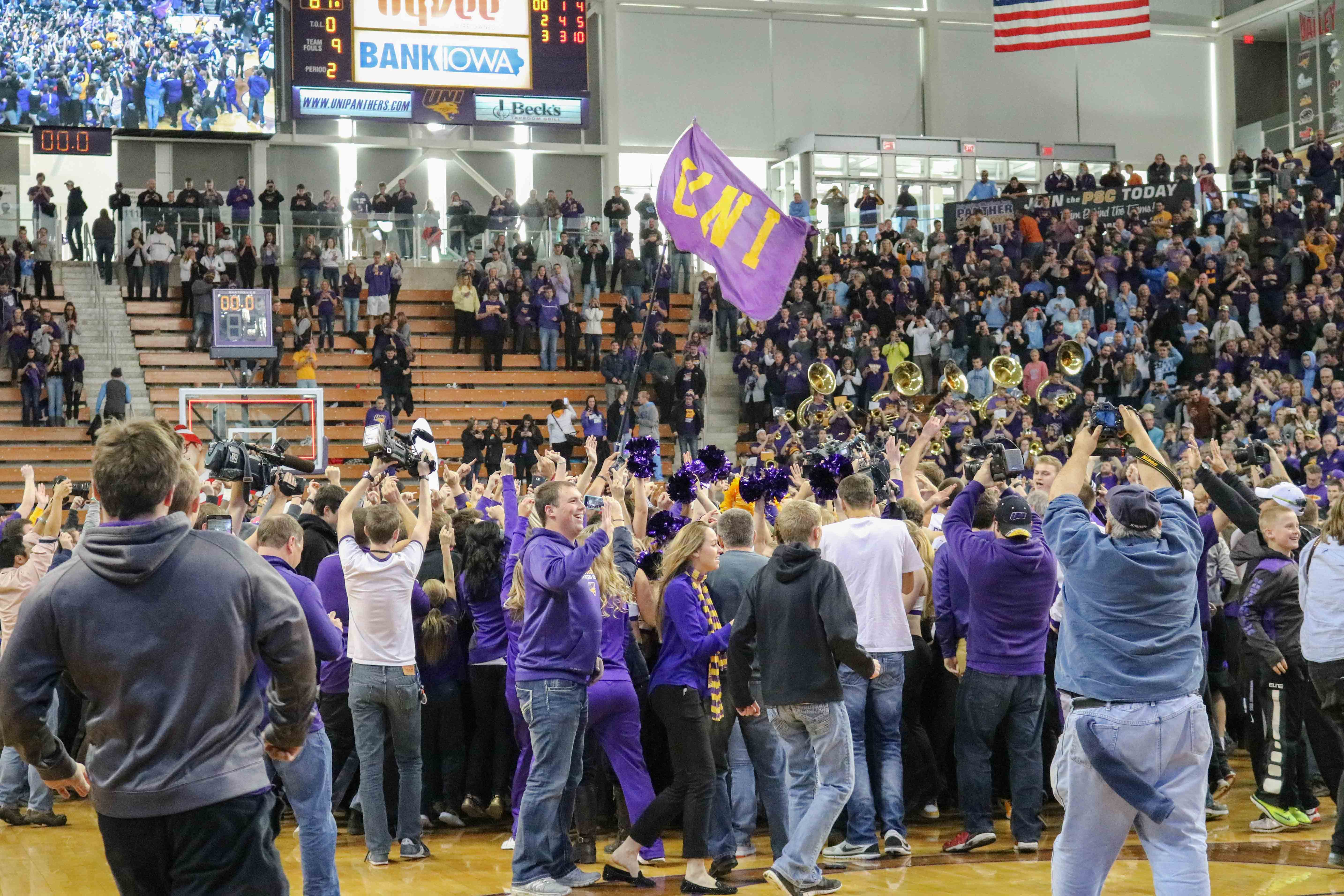Students and fans storm the court after UNI's victory over North Carolina from last year's season.