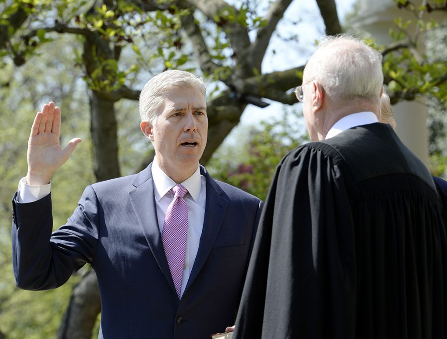 Justice+Anthony+Kennedy+swears+in+Neil+Gorsuch+as+an+Associate+Justice+of+the+Supreme+Court+April+10.+