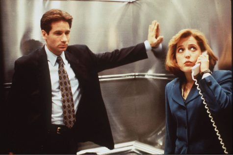 "Agents Fox Mulder (left) and Dana Scully (right), who specialize in ""X-File"" cases, are pictured here phoning for help after getting stuck in the Dancer Hall elevator in the middle of her investigation."