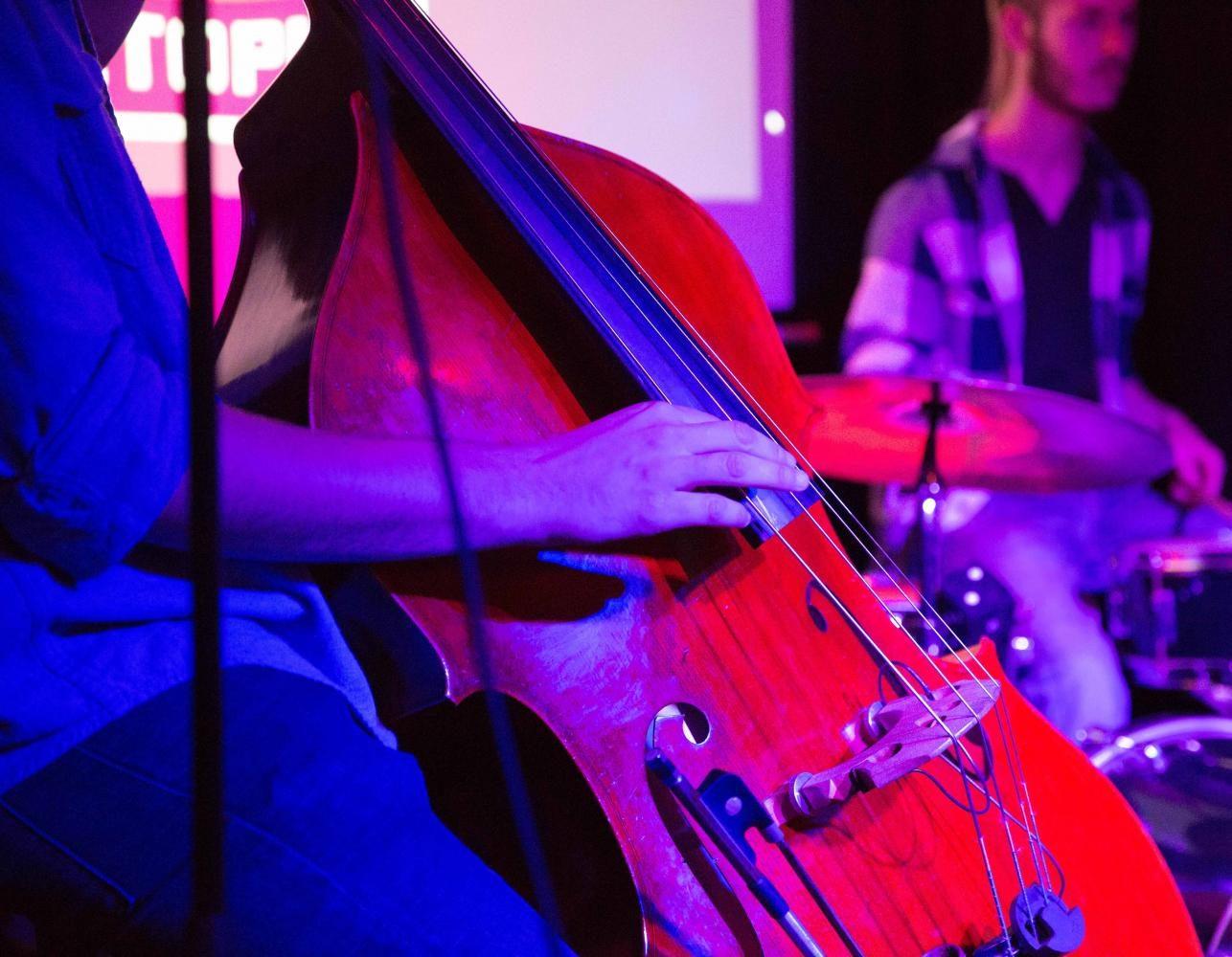 Jazz studies major Clayton Ryan, who organized Monday's jazz jam, played standup bass on the Octopus stage.