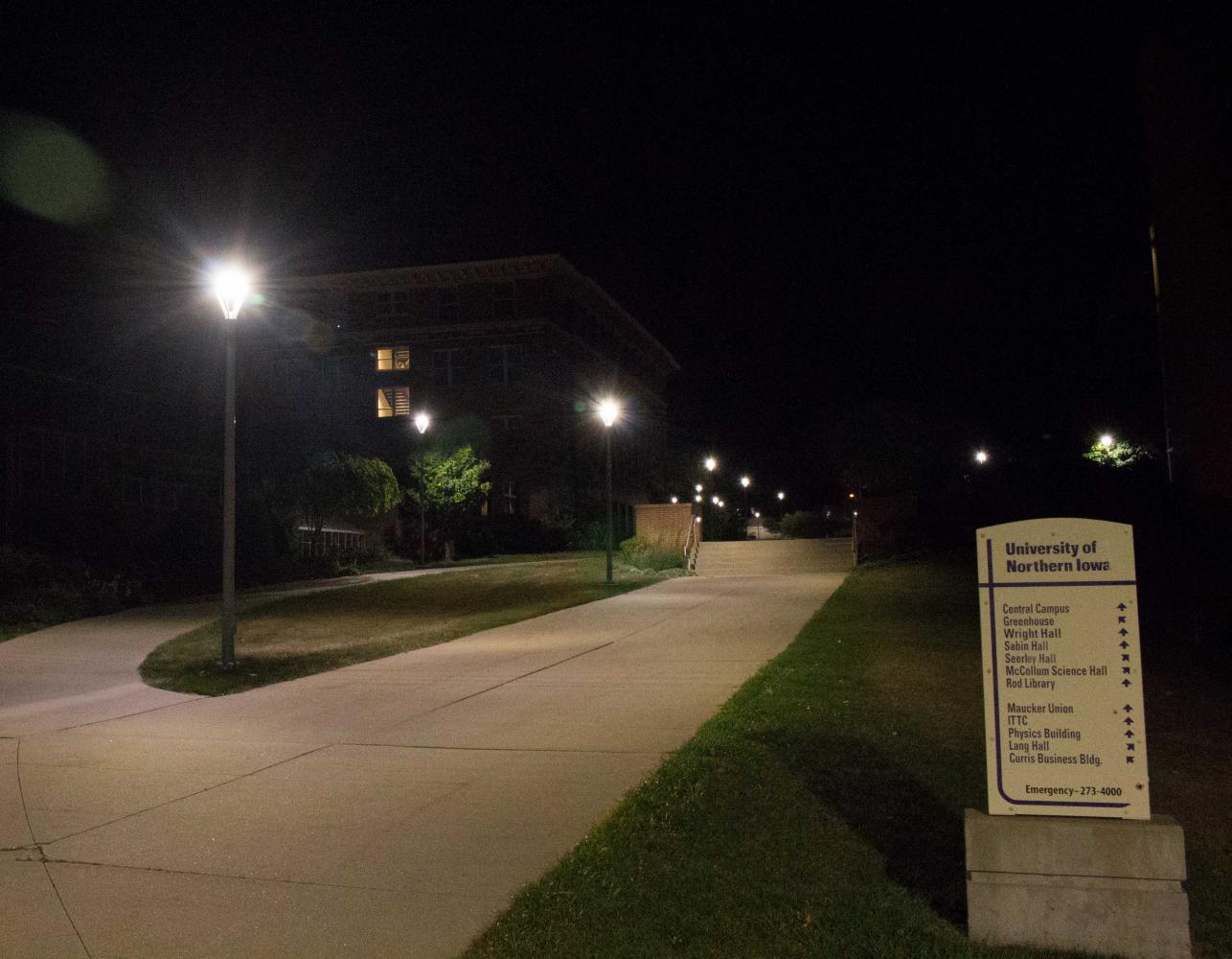 The sidewalk lights across campus were recently replaced with newer models that produce whiter light.