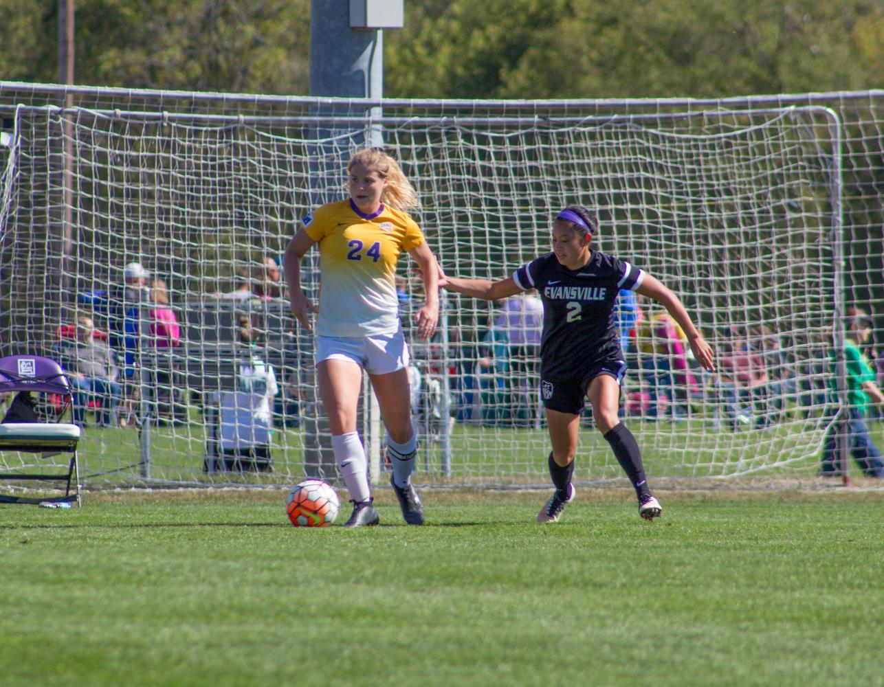 Sarah Brandt (24) bodies an opposing defender at a recent home game in Cedar Falls.