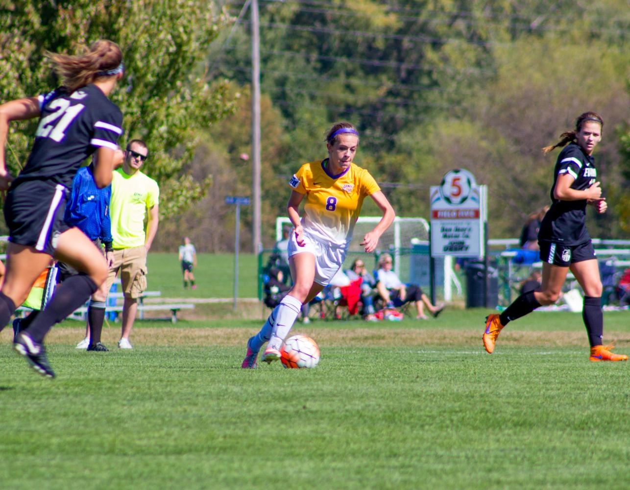Hannah McDevitt (8) dribbles and looks to score.