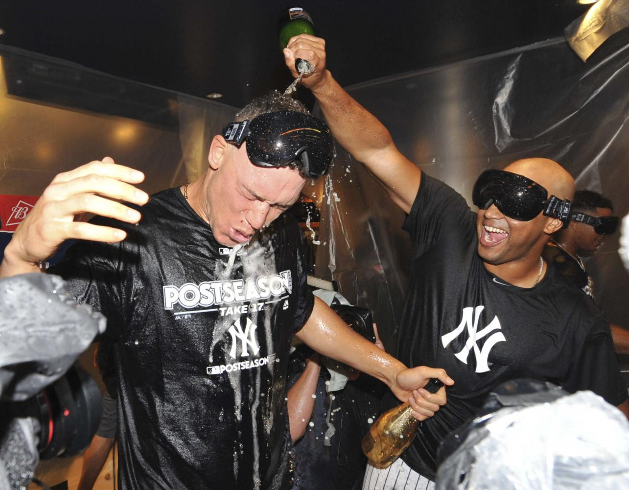 Aaron Judge (left) is doused by CC Sabathia (right) after an 8-4 American Wild Card win at Yankee Stadium against the Minnesota Twins.