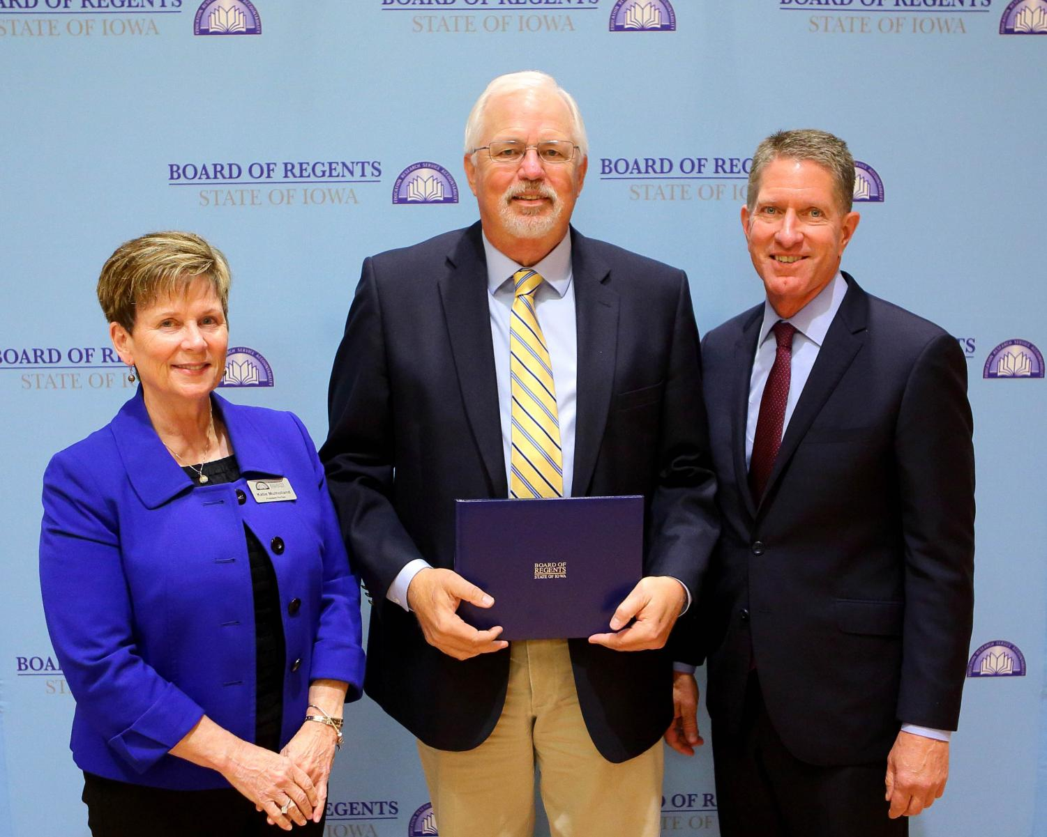 Rex Karsten (center), pictured here receiving the Iowa Board of Regents Faculty Excellence Award, passed away on Dec. 11 of last year at age 67.