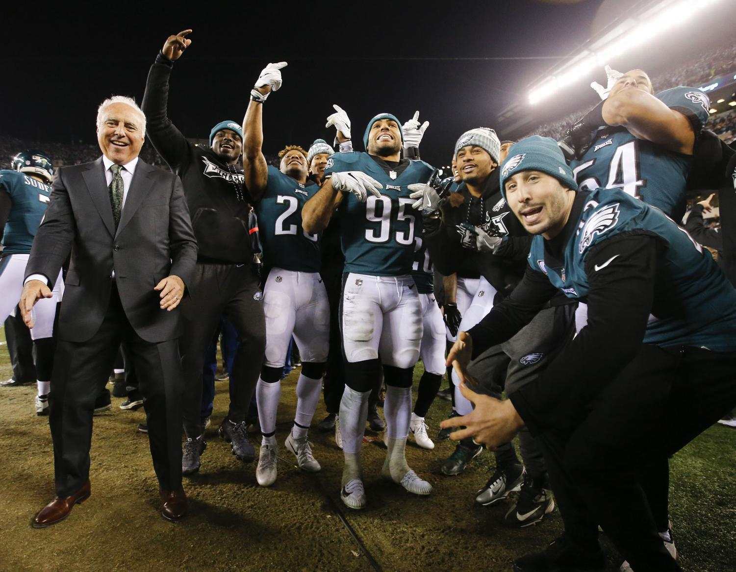 Jeffery Lurie, owner of the Philadelphia Eagles, celebrates with his team after beating the Minnesota Vikings in the NFC Championship.