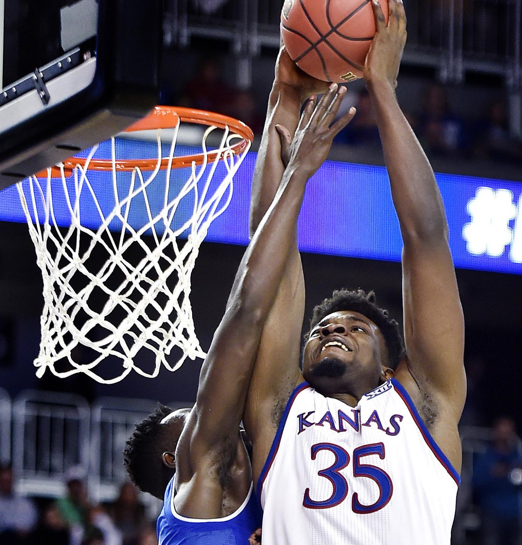 Kansas' Udoka Azubuike (35) dunks over Seton Hall's Ismael Sanogo.