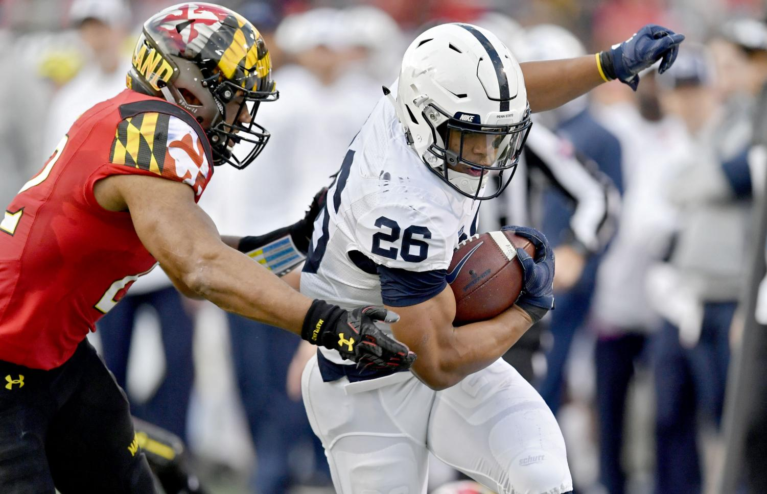Penn State running back Saquon Barkley (26) jets past a Maryland defender.