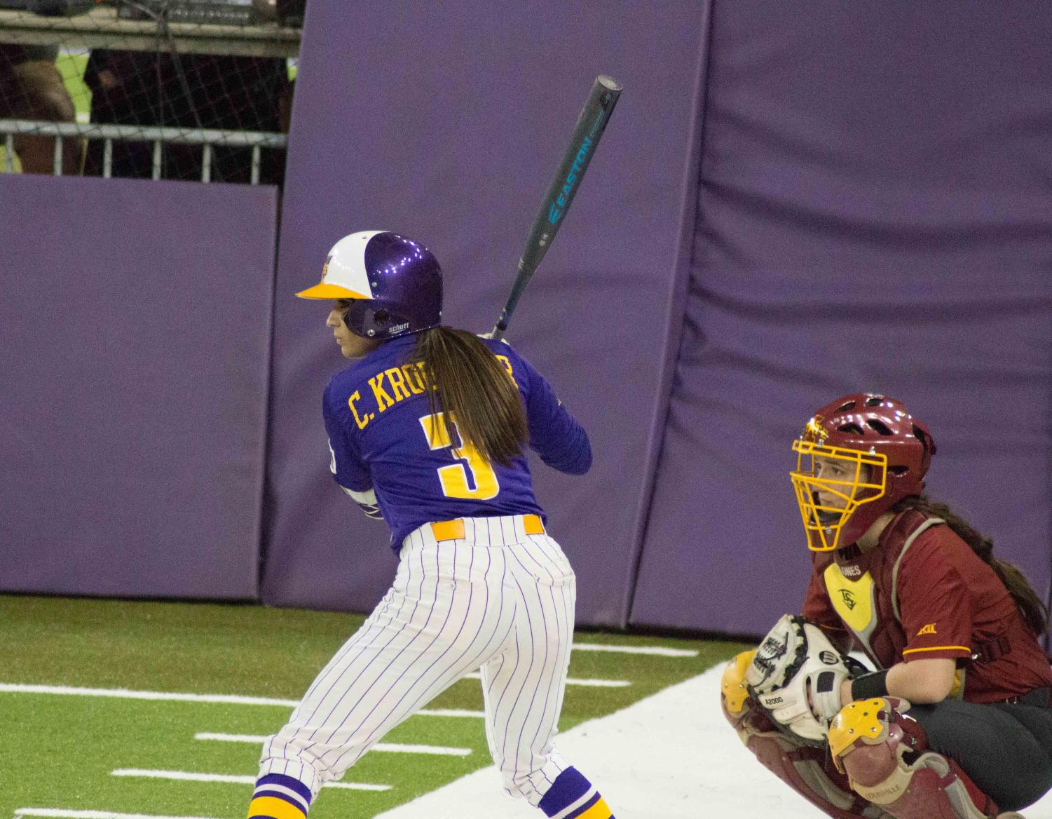 Junior Courtney Krodinger (3) steps into the batter's box against the Iowa State Cyclones last Thursday in the UNI-Dome.