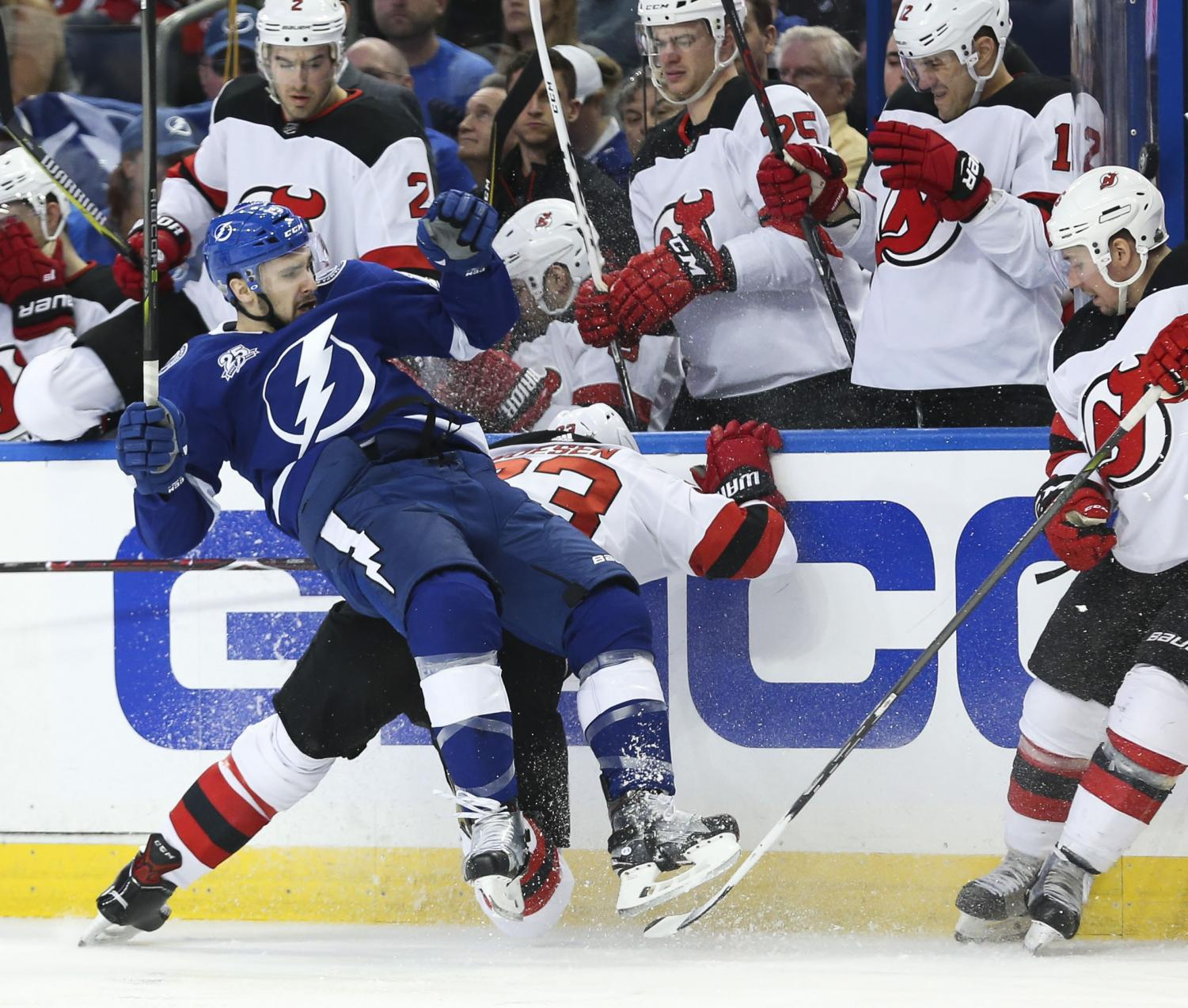Tampa Bay center Cedric Paquette (left) collides with New Jersey's Stefen Noesen (23) during their first round playoff game on Saturday.