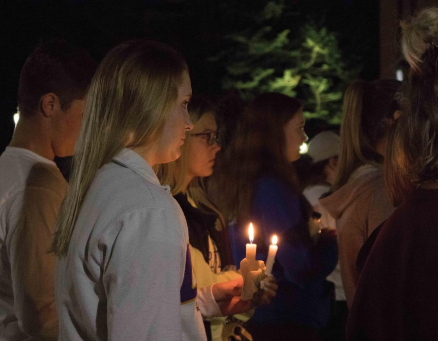 Nearly+120+students+gathered+at+the+Campanile+on+Wednesday%2C+August+22+for+a+candlelight+vigil+for+those+who+have+gone+missing%2C+including+Mollie+Tibbetts+and+Jake+Wilson.
