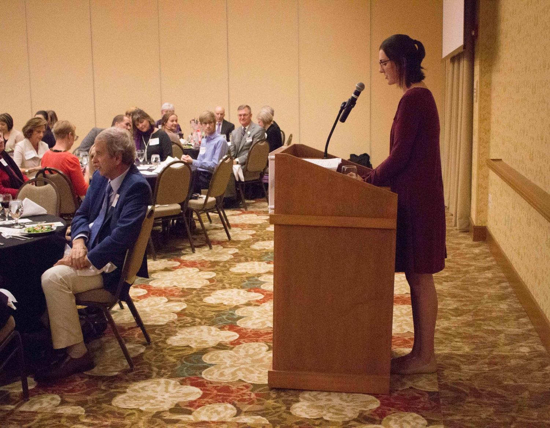 Scholarship winner Erin Thomason introduces ambassador Nancy Powell.