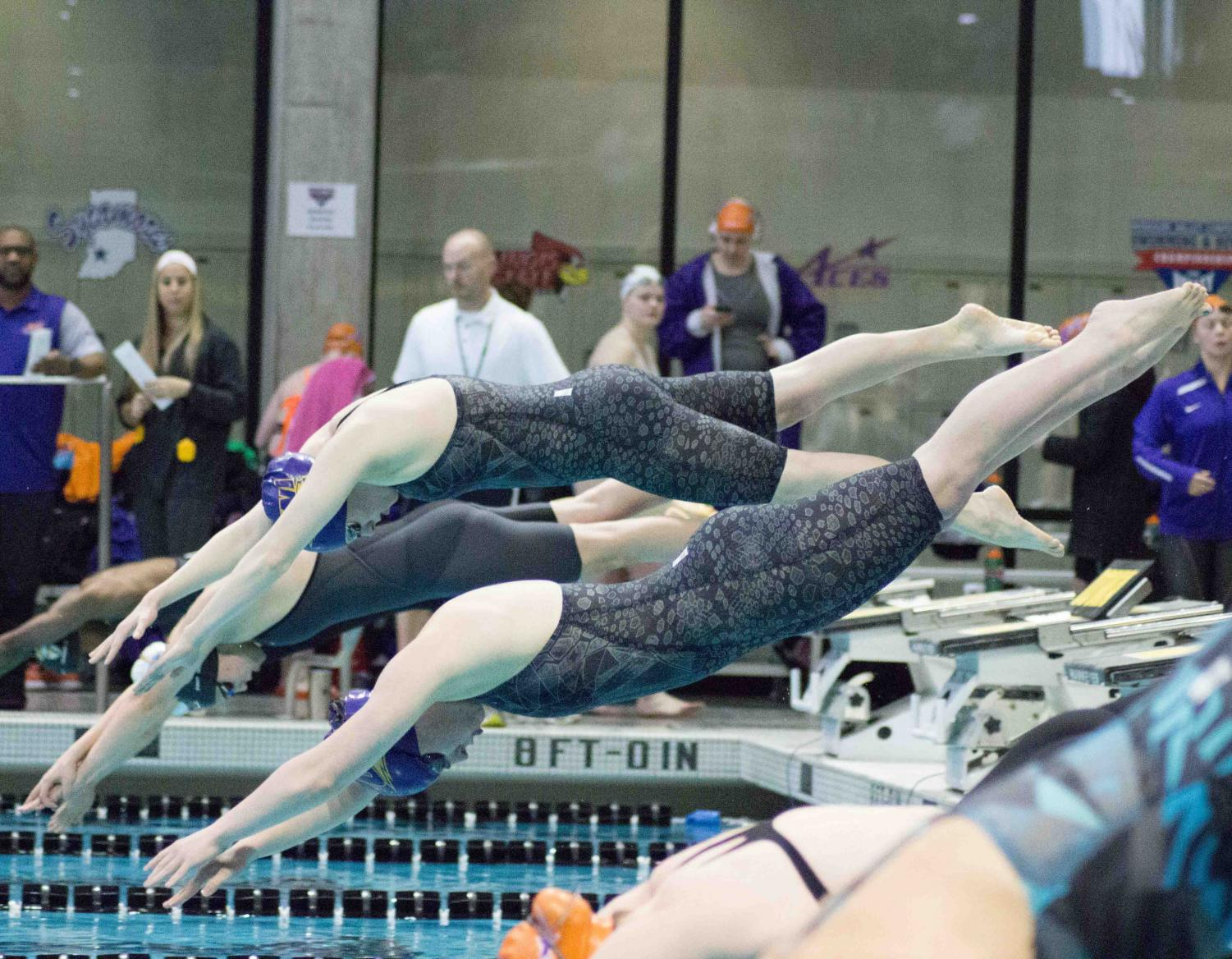 UNI swimmers launch from the starting blocks during last season's MVC Championship meet in Iowa City. The Panthers finished third at the meet under first year head coach Nick Lakin.