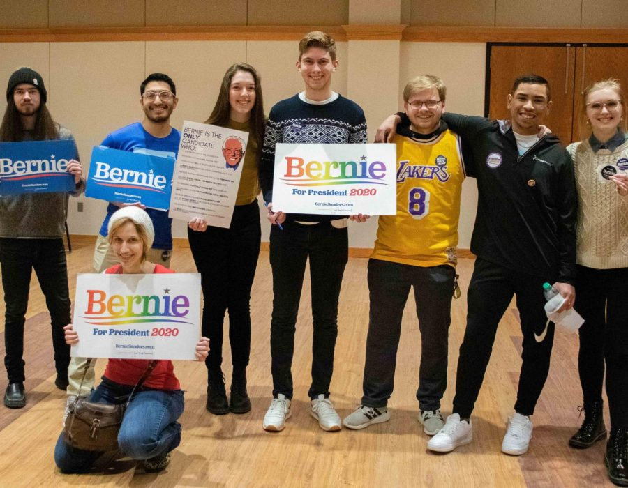 A+group+of+Sanders+supporters+pose+for+a+photo+at+Maucker+Union%E2%80%99s+mock+caucus+on+Monday%2C+Jan.+27.