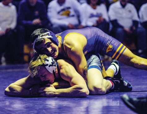 Wrestling remains undefeated in Big 12 duals