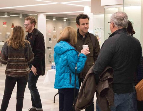 UNI alum and filmmaker Brendon Leonard mingles with attendees of 2019's MountainFilm On Tour at UNI.