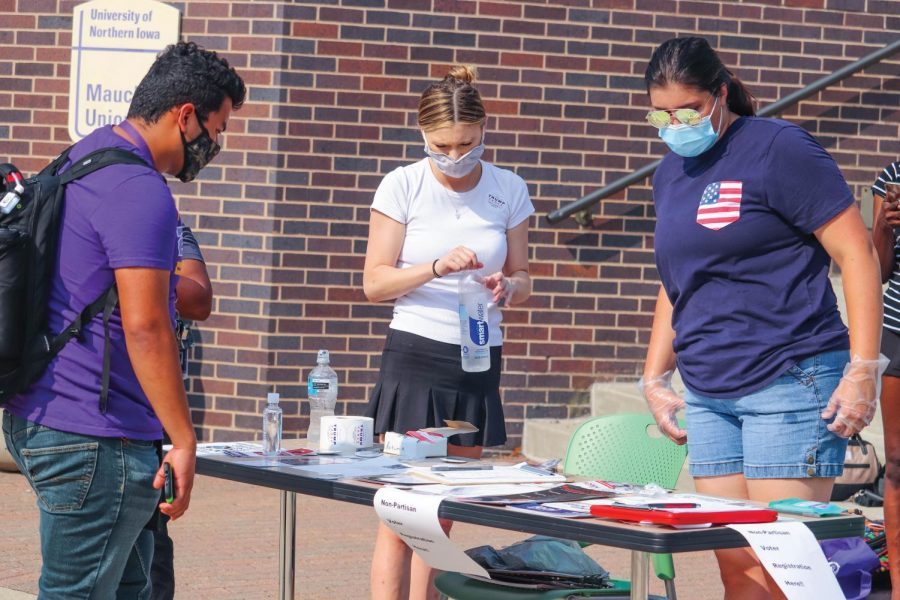 Students stop at a registration table outside Maucker Union at the