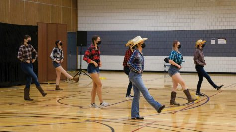Members of the Illuminate Dance Troupe (IDT) perform a country barn dance during a performance on Sept. 12. The show featured pieces from the groups spring 2020 show, which was postponed due to COVID-19.