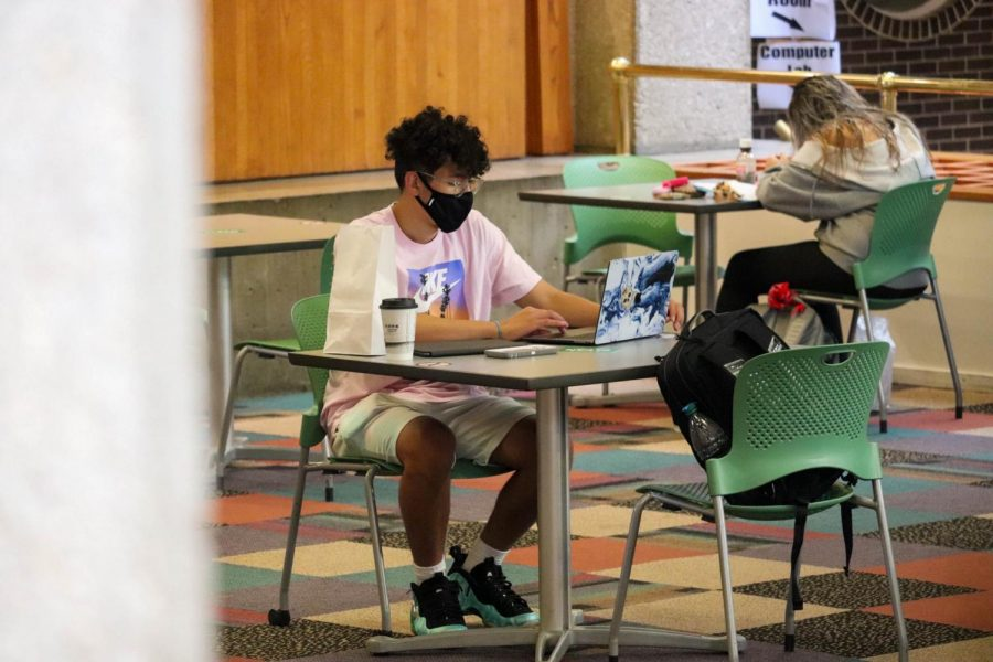 Students study in Maucker Union while wearing masks. The UNI Student Health Center has released its second week of COVID-19 data, indicating a slight decline in the campus positivity rate and number of positive tests.