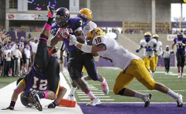 UNI Running Back David Johnson crosses into the endzone for one of his two touchdowns in the Panther's 41-6 rout of McNeese State on Sept. 28, 2013.