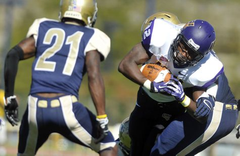 UNI running back Tyvis Smith tries to break away from Northern Colorado