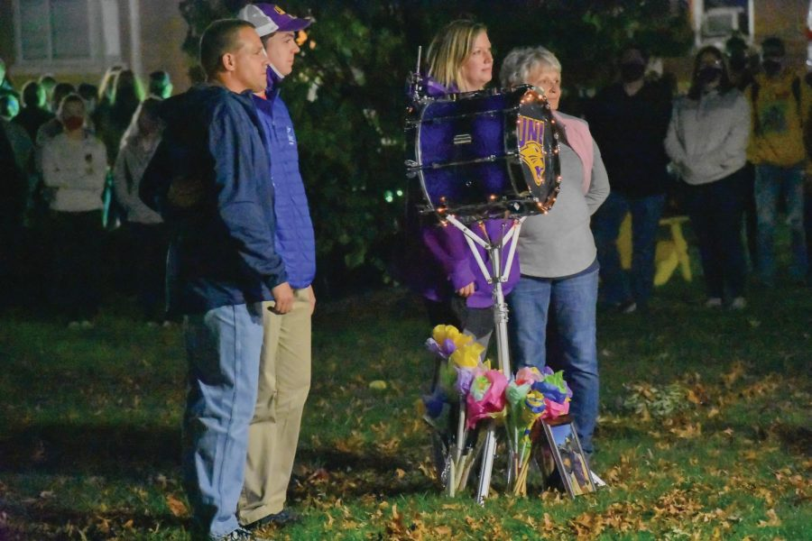 Issac Roerig's family stood around his decorated drum during the memorial service Monday night