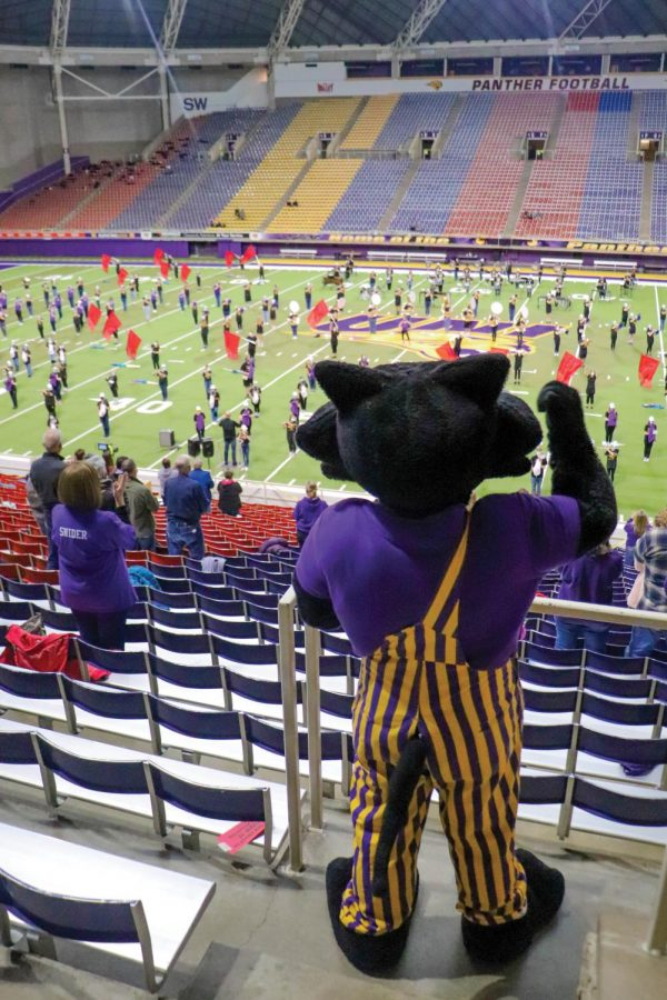 TC enjoys the spirited music of the Panther Marching Band in the UNI-Dome as they play familiar songs from the movies.