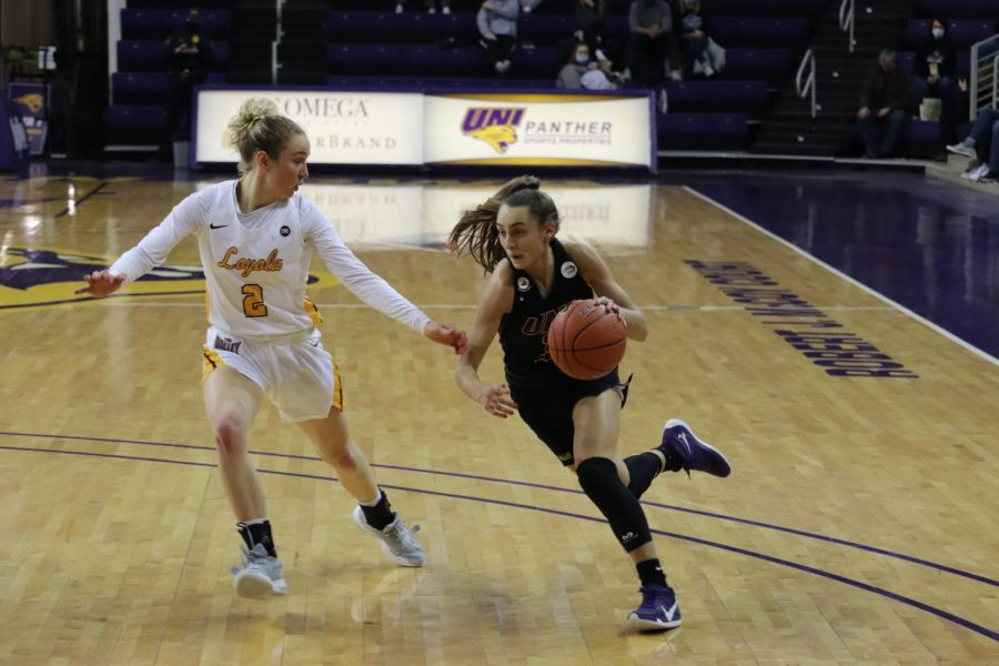 UNI's Karli Rucker drives in against Loyola's Ellie Rice in the second game of the team's weekend series. The Panthers dropped the second game in overtime.