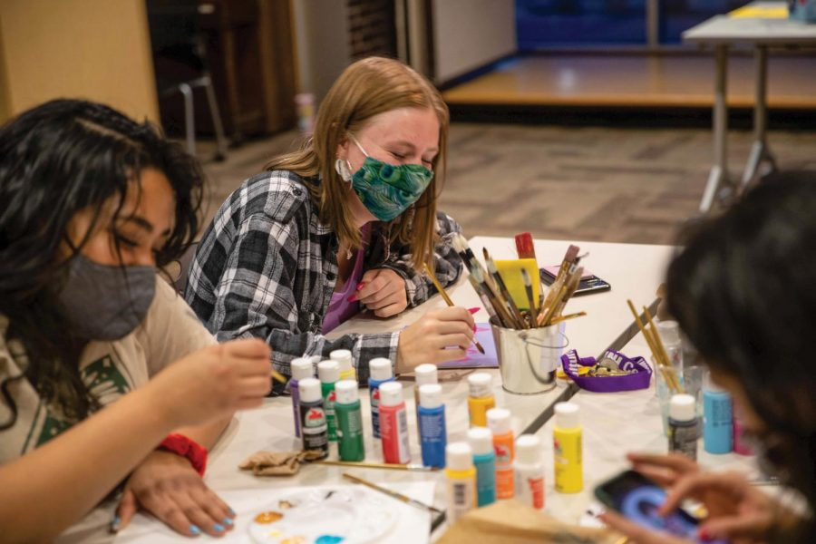 Students participate in an arts and crafts event hosted by CMA and the Northern Iowa Feminists.