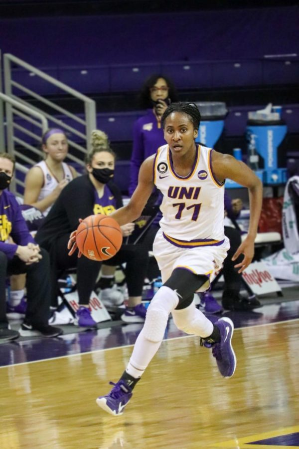 UNI's Bre Gunnels brings the ball up the floor. She led the Panthers with 11 rebounds in Saturday's game against Evansville.