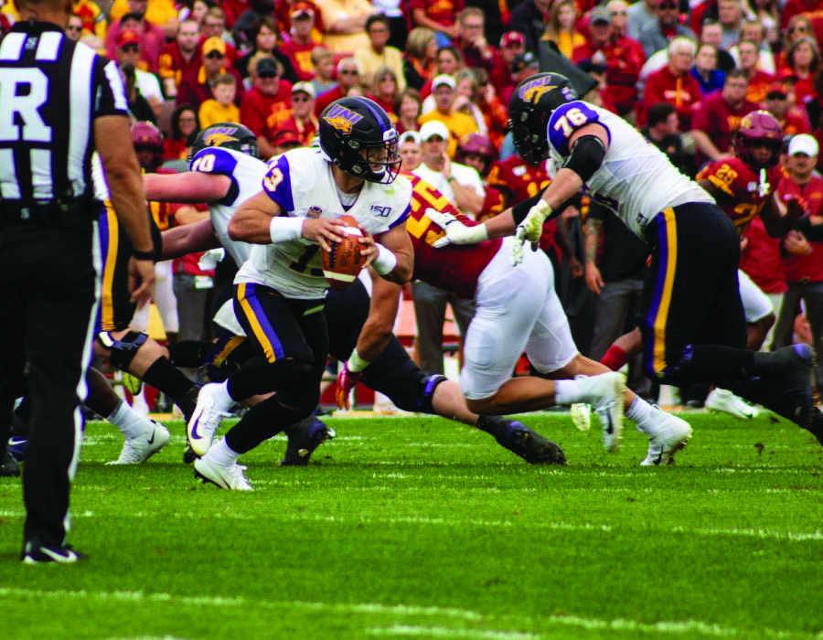 UNI quarterback Will McElvain takes the snap against Iowa State during the last time the two in-state rivals met back on Aug. 31, 2019. Iowa State eventually prevailed in the game, 29-26. The Panthers will look to pull off the upset this time on Sept. 4.