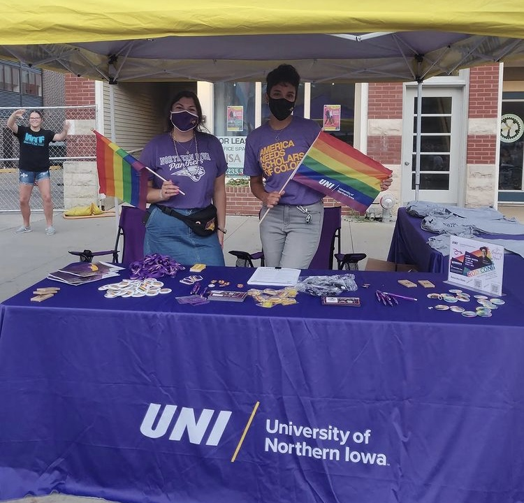 UNI LGBTQ+ members show off their UNI gear and pride merchandise Saturday. Many informational booths were set up for attendees.