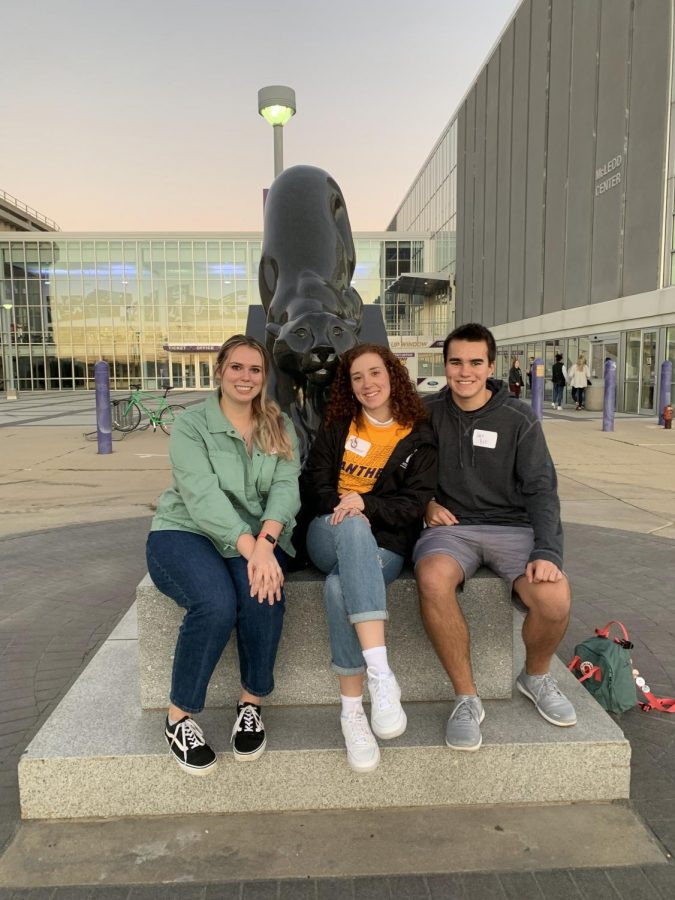 Colette Stanford, Kat Gainer and Jace Bell complete the Granite Panther tradition by the UNI-Dome. If students complete the traditions challenge, they receive a pin or medallion at graduation.