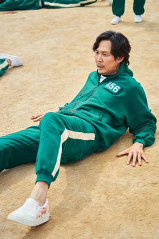 Player 456, also known as Seong Gi-hun, is played by Lee Jung-jae and is seen on the floor frozen during the early games.